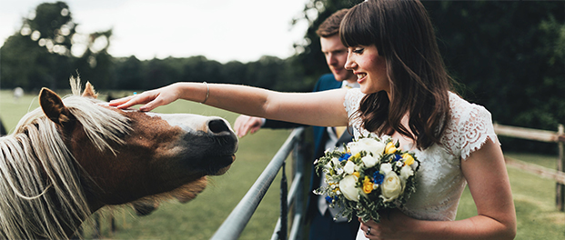 relaxed bride and groom photos with horses