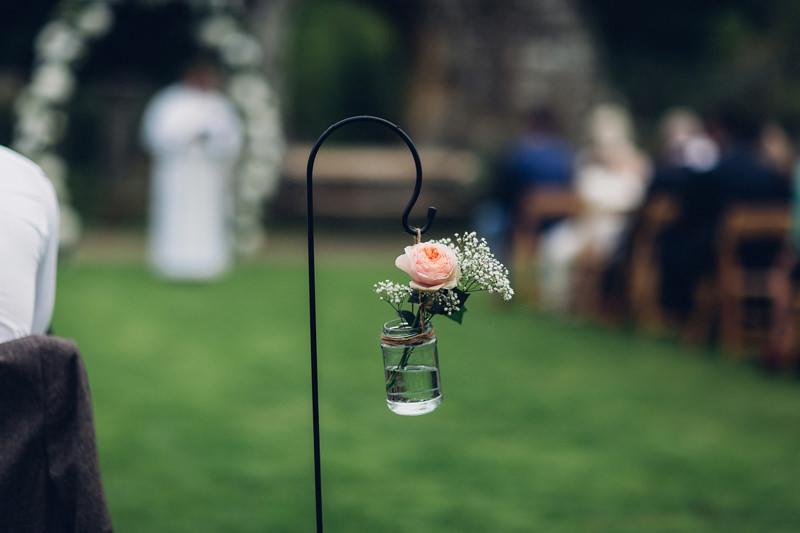 flowers in jars outdoor wedding
