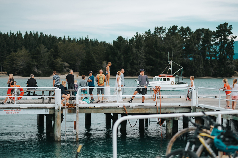 bride and goom on Mapua Wharf by nelson wedding photographer miss gen