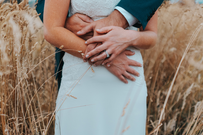 bride and groom in field by modern australia wedding photographer Miss Gen