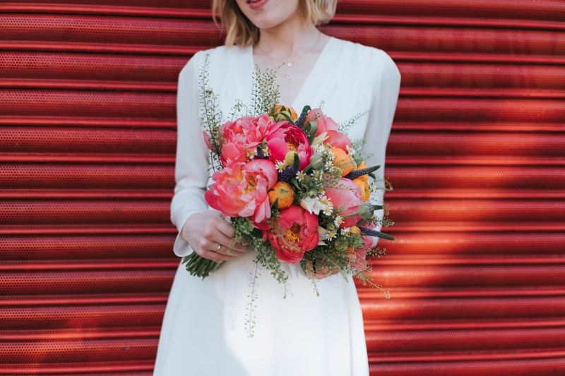 Colourful pink and red bridal bouquet with peony by creative modern wedding photographer Miss Gen