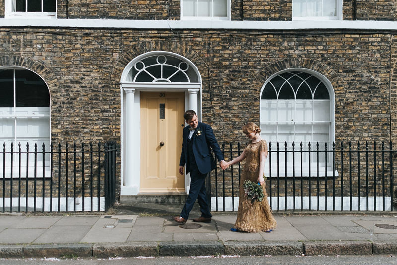 contemporary bride and groom portrait in London with bride in gold sequin dress by Eliza Jane Howell by destination wedding photographer Miss Gen