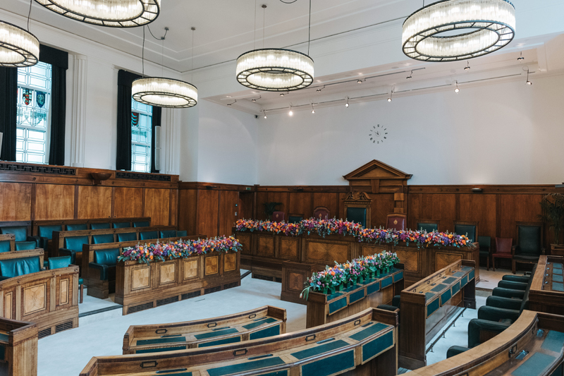 colourful wedding flowers in council chamber at town hall hotel by miss gen