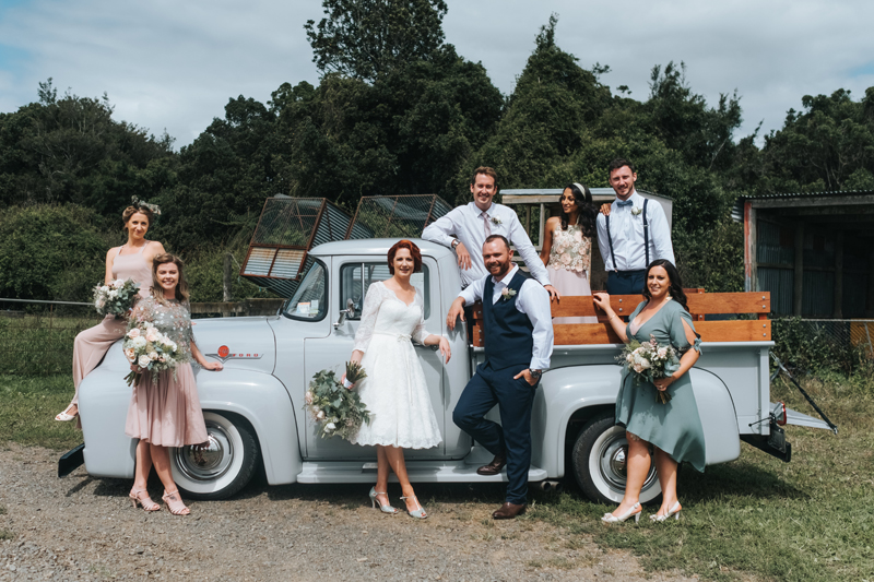 wedding party on a vintage truck in new zealand