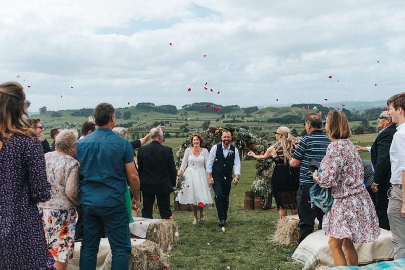 confetti at outdoor countryside wedding in new zealand by modern wedding photographer miss gen