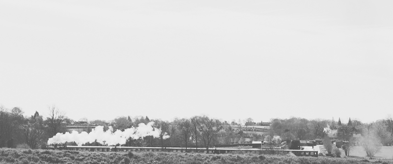 Travel photography at Bodiam Castle in East Sussex England - Steam Train and countryside.