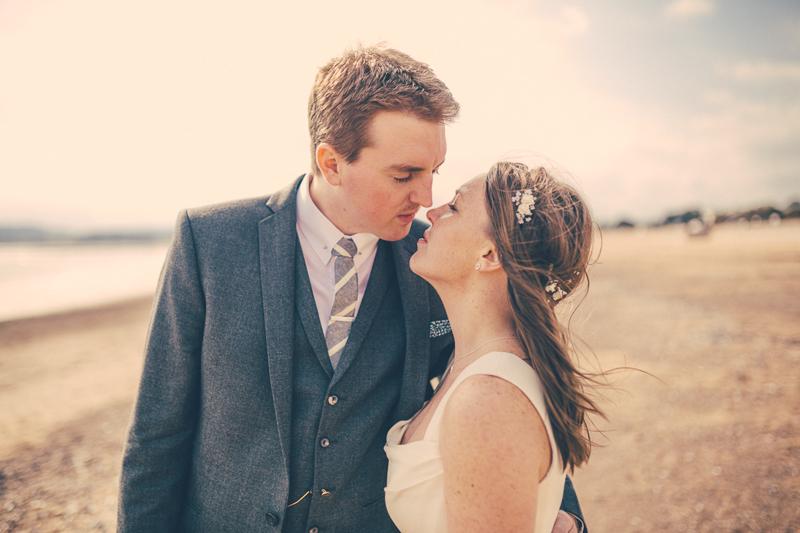 Devon wedding bride and groom on beach