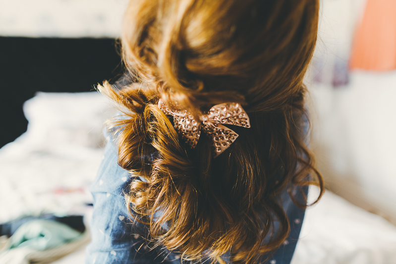 Flower girls hair with big sparkly bow