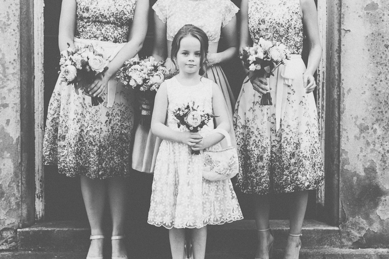 Bridal party - flower girl with bridesmaids and bride in black and white