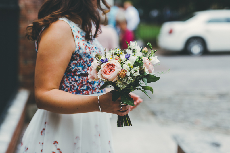 Bridesmaid with bouquet outside Portsmouth Registry Office