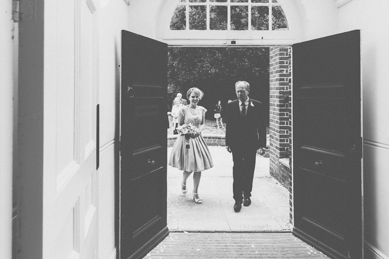 Bride and father of the bride walking in to Portsmouth Registry Office