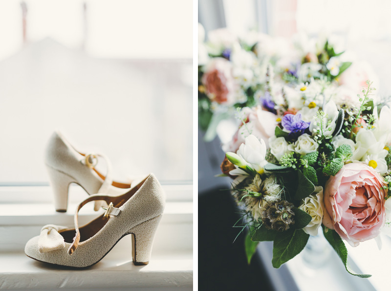 Cream beaded wedding shoes on a windowsill and bridal bouquets