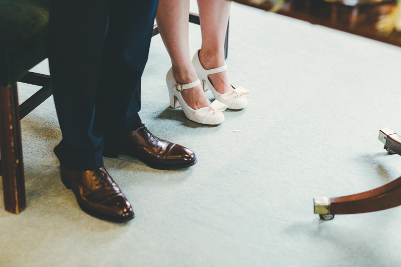 Bride and groom's shoes during the wedding ceremony at Portsmouth Registry Office