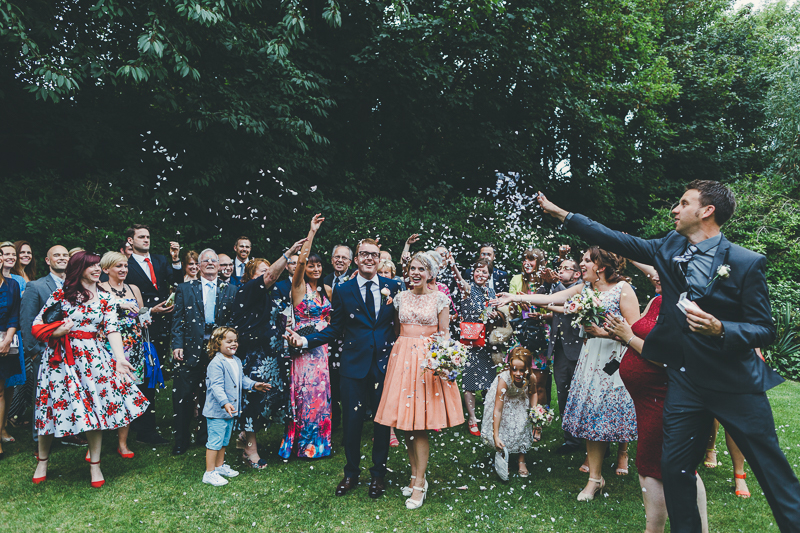 natural photos of the bride and groom in the gardens at Portsmouth Registry Office - confetti