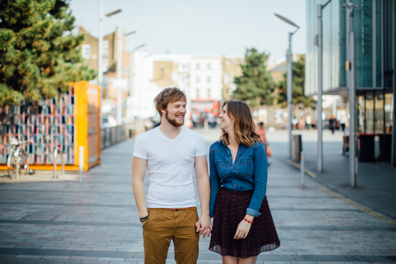 Couple standing in the street. Couple portrait photography session in Dalston, London by Miss Gen Photography - London and destination wedding photographer.