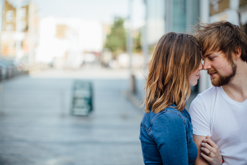 Couple hugging in street. Couple portrait photography session in Dalston, London by Miss Gen Photography - London and destination wedding photographer.
