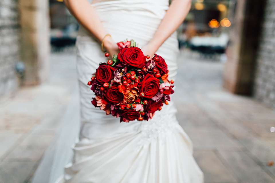 Bride holding a red bouquet at Thornbridge Hall in Derbyshire, Peak District. Creative, contemporary, alternative, natural wedding photography at Thornbridge Hall in the Peak District - Miss Gen Photography, London and destination wedding photographer.