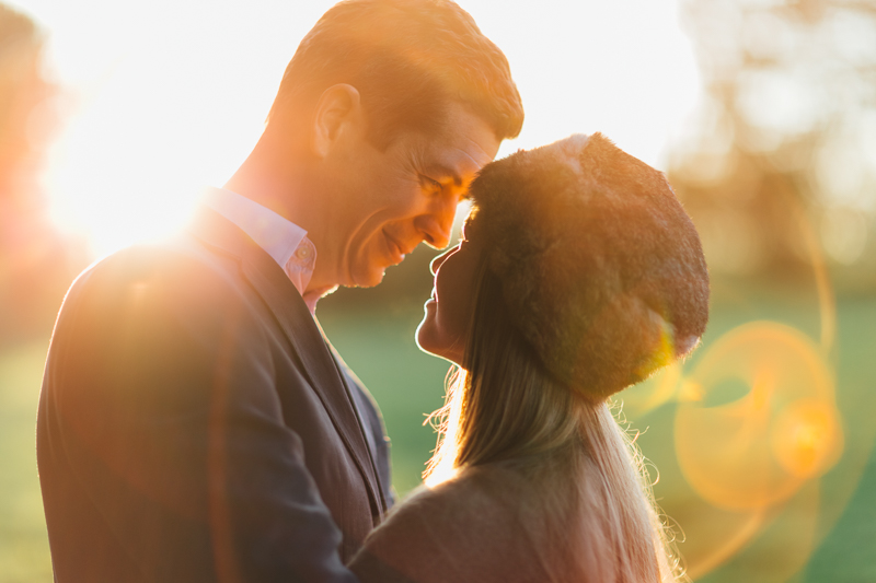 golden hour portrait of bride and groom with sun flare