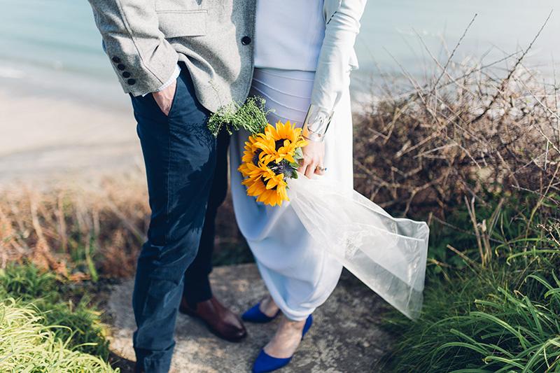 beach wedding portrait in cornwall with sunflower bouquet