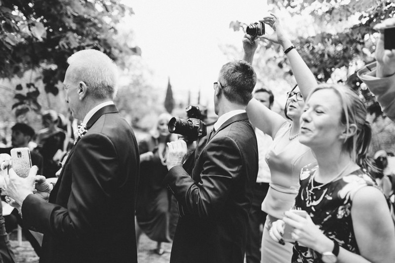 wedding guests with cameras