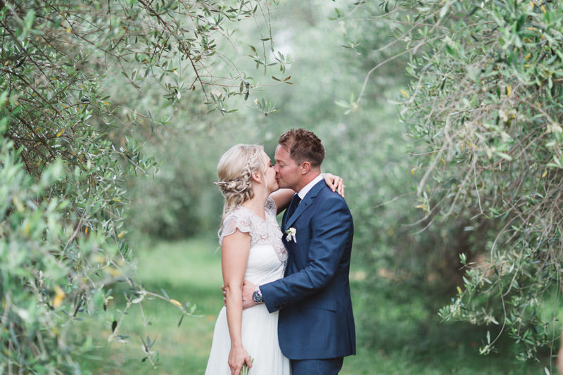bride and groom in olive grove in provence france