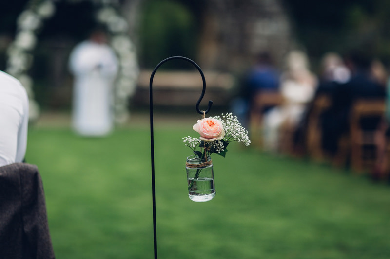 flowers in jars outdoor wedding