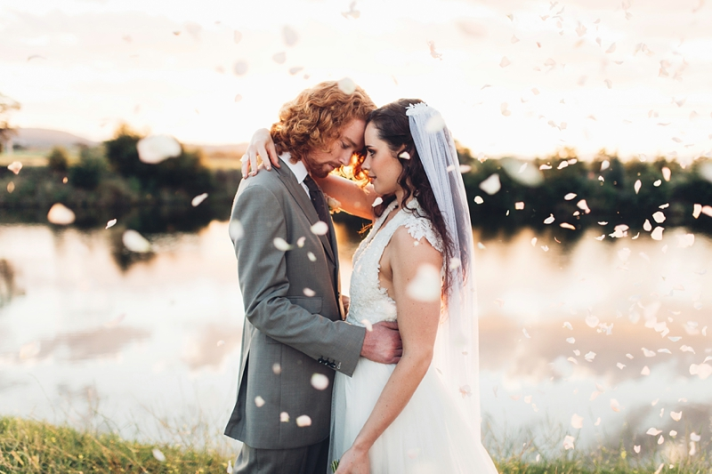 Bride & Groom with confetti by Molonglo River by Canberra wedding photographer MissGen