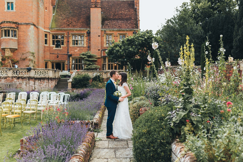 bride and groom in formal garden at lanwades hall by london wedding photographer miss gen