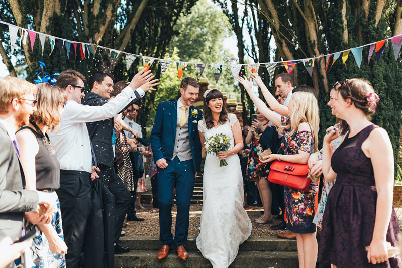 confetti shot of bride and groom by relaxed natural wedding photographer, miss gen