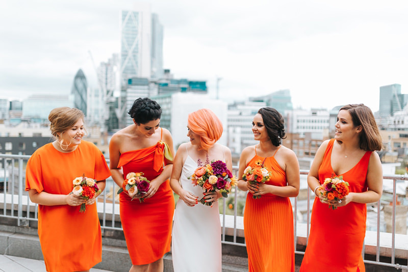 bride with pink hair and bridesmaids in orange for a london rooftop wedding at the Ace Hotel in Shoreditch by Miss Gen, London wedding photographer