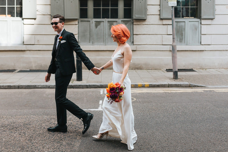 creative reportage wedding photography, bride and groom walking in East London by miss gen