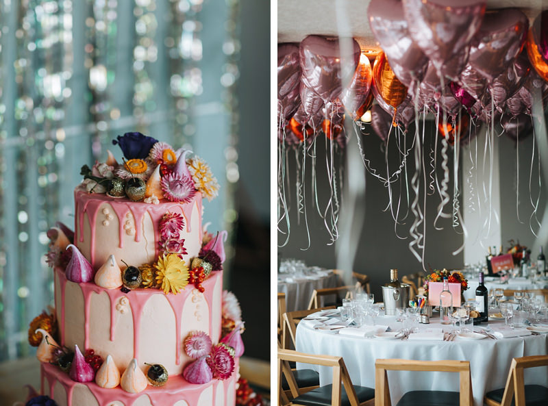 pretty pink wedding cake with pink and orange heart helium balloons at the ace hotel by london wedding photographer, miss gen