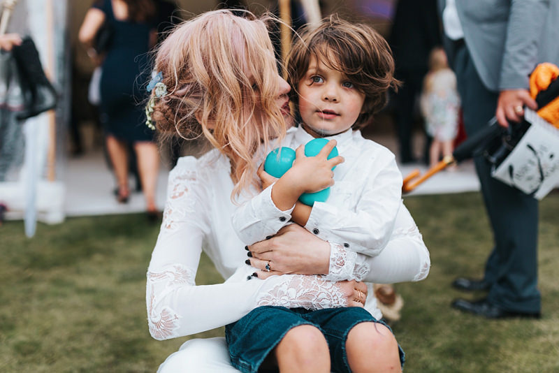 bride and son portrait by natural documentary wedding photographer missgen