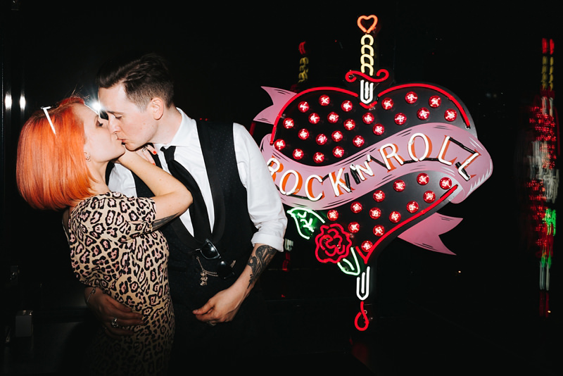 Bride and Groom with Rock'N'Roll neon sign at the Ace Hotel in Shoreditch, East London by Miss Gen, destination wedding photographer