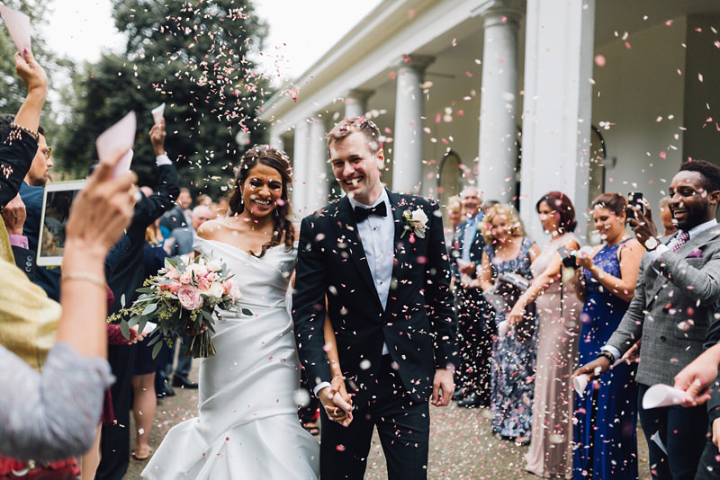 confetti shot with bride and groom outside church in Clapham by east london wedding photographer miss gen
