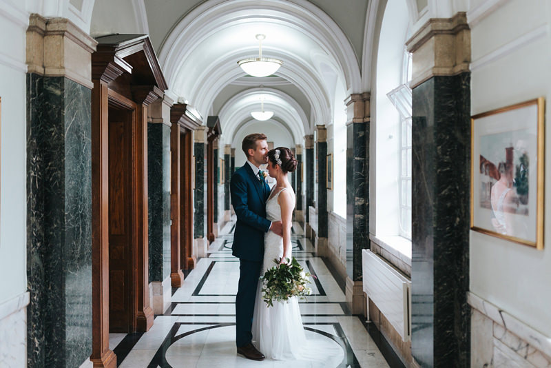 bride and groom at islington town hall by creative modern wedding photographer miss gen