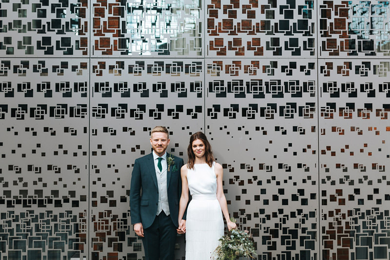bride and groom at town hall hotel by modern east london wedding photographer miss gen