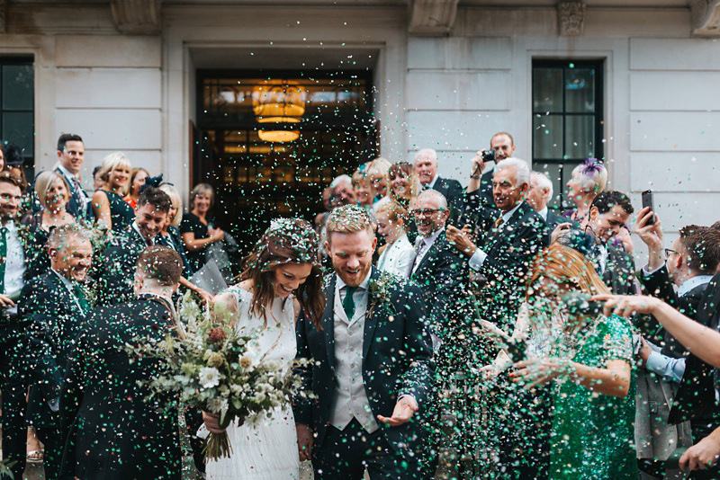 beautiful confetti shot outside town hall hotel in east london by destination wedding photographer miss gen