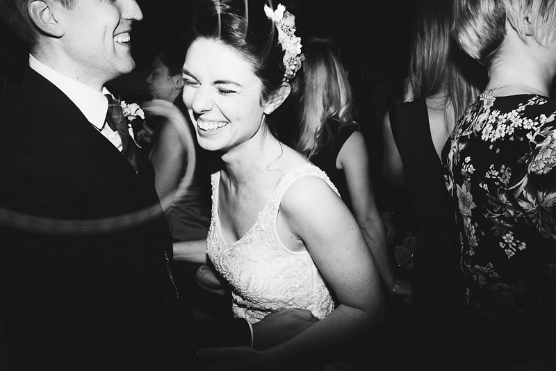 natural photo of bride and groom dancing at their East London wedding by alternative modern wedding photographer Miss Gen