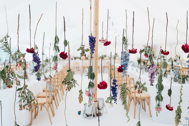 individual hanging flowers in modern botanical marquee wedding design