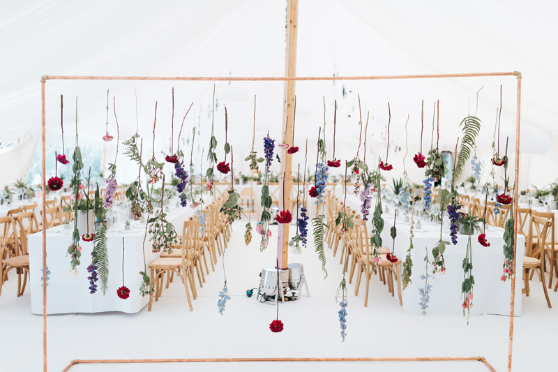 minimalist botanical wedding with individual hanging flowers