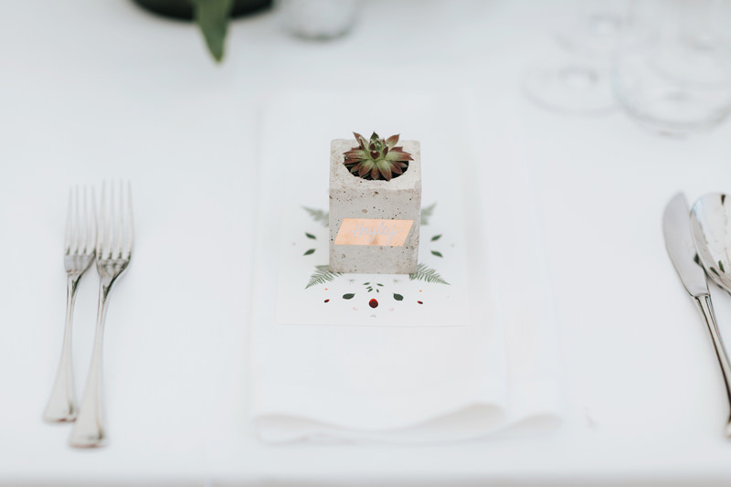 mini concrete pot with succulent as wedding favour in modern botanical wedding