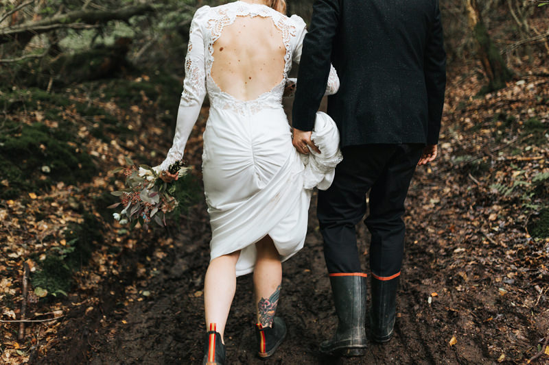 bride and groom walking in woodland setting by destination wedding photographer miss gen
