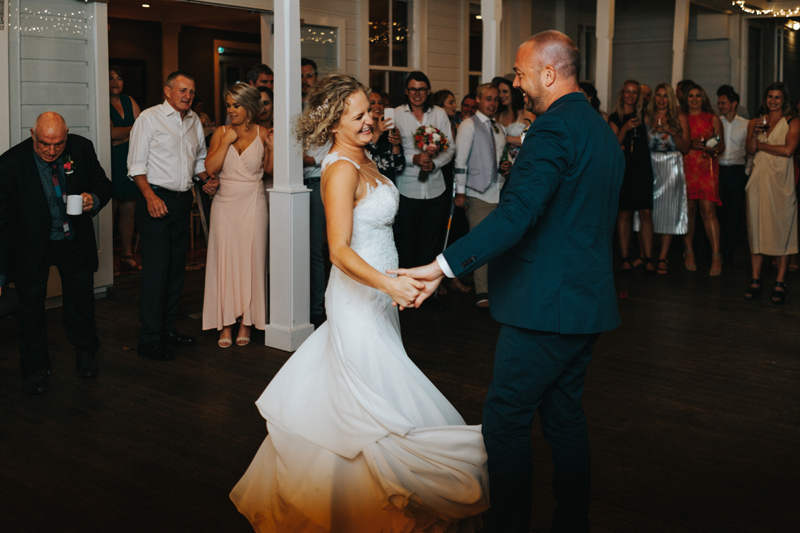 bride and groom first dance at the Hilton, Lake Taupo by creative reportage destination wedding photographer Miss Gen