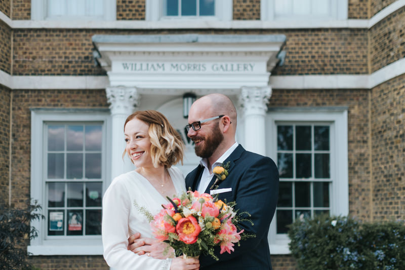 bride and groom outside the william morris gallery in Walthamstow by wedding photographer Miss Gen