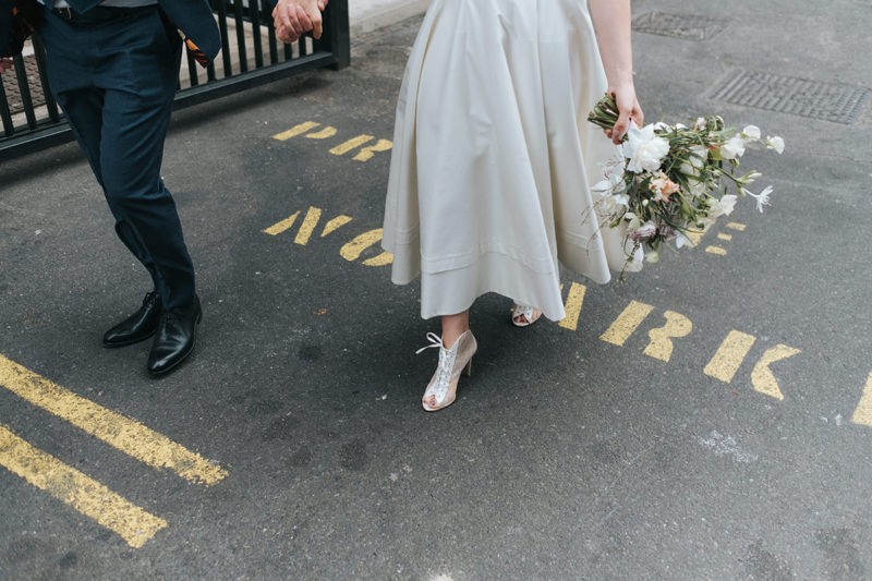 bride and groom walking in east london by modern wedding photographer Miss Gen