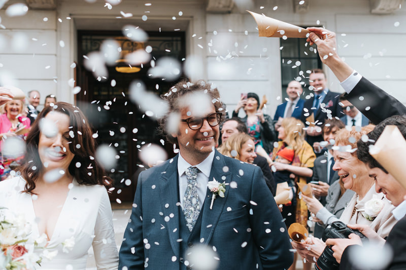 bride and groom confetti town hall hotel bethnal green london by miss gen