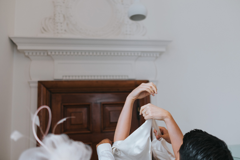 natural bridal prep moment captured by creative london wedding photographer miss gen