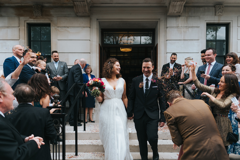 confetti on the steps of the town hall hotel by london wedding photographer miss gen