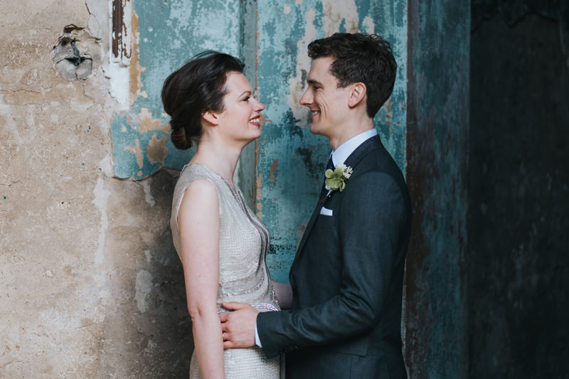 bride and groom at Asylum Chapel in Peckham London by alternative modern wedding photographer Miss Gen. Bride wears Jenny Packham beaded champagne coloured wedding dress.